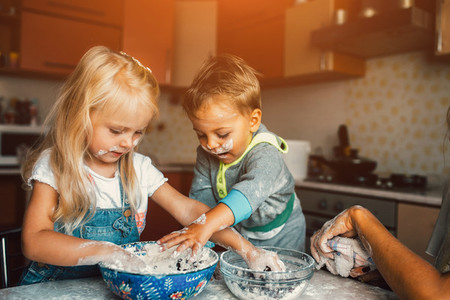 Kids is playing with flour