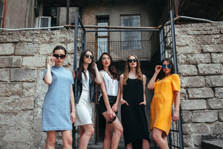 Five young beautiful girls in the city