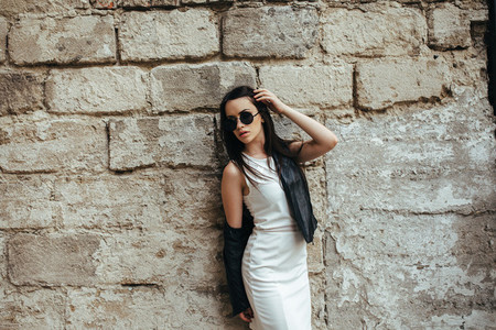 Attractive fashion woman in white dress