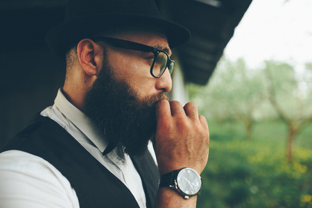 bearded man looks into the distance