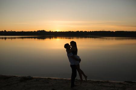 Couple in sunrise on the beach
