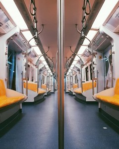 Yellow seats inside sky train