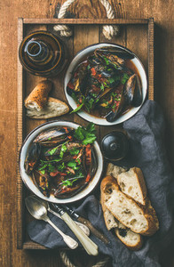 Flat lay of Belgian boiled mussels in tomato sauce and beer