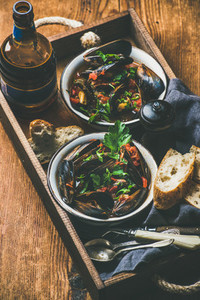Belgian boiled mussels in tomato sauce and beer in bottle