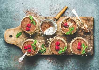 Homemade dessert Tiramisu in glasses on wooden board