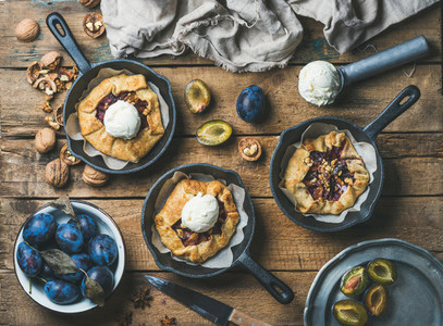 Plum and walnut crostata pie with ice cream scoops