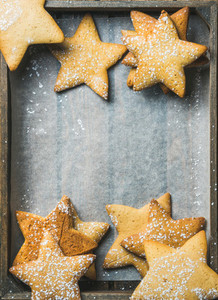 Sweet Christmas gingerbread cookies in shape of stars  copy space