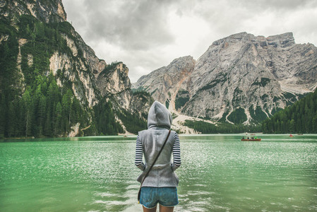 Young woman traveller standing and looking at Lago di Braies
