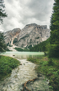 Mountain Lake in Valle di Braies surrounded by green forests