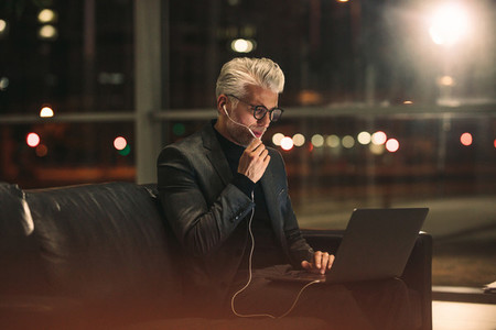 Mature businessman working late at night in office