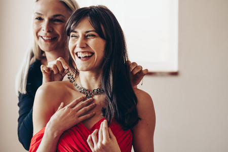 Portrait of smiling mother and daughter dressing up