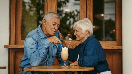 Beautiful senior couple in love at cafe
