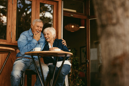 Retirement couple relaxing at cafe