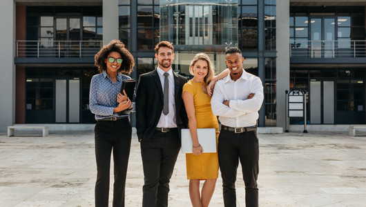 Diverse group of business professionals standing outdoors