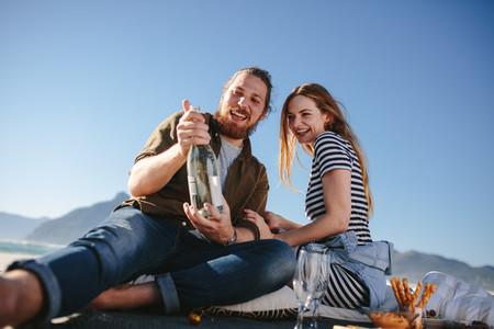 Beautiful couple having a picnic on the beach