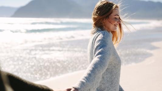Woman walking along the beach with her boyfriend