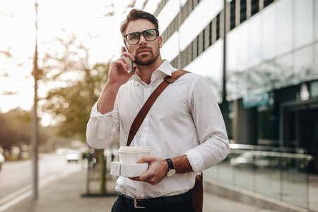 Man talking on cell phone while walking on street