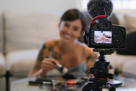 Woman making a video blog on cosmetics