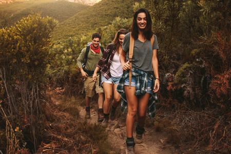 Friends hiking on rugged hilly terrain