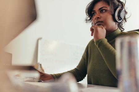 Female programmer working on computer