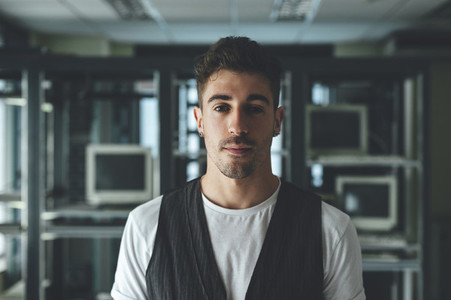Portrait of a handsome man in an abandoned building