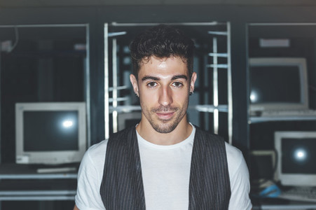 Portrait of a handsome man in an abandoned building illuminated with a ring flash