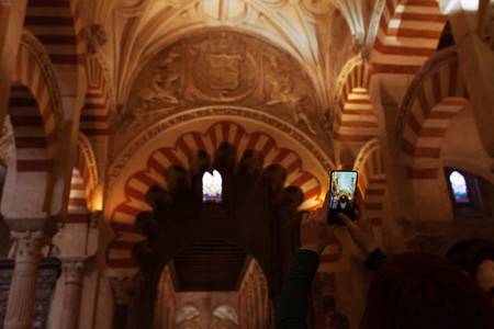 Young woman taken a photo with her phone to the mosque
