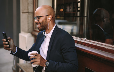 African businessman making a video call with smartphone