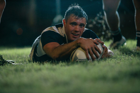 Rugby player scoring a try