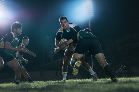 Intense rugby action at sports arena
