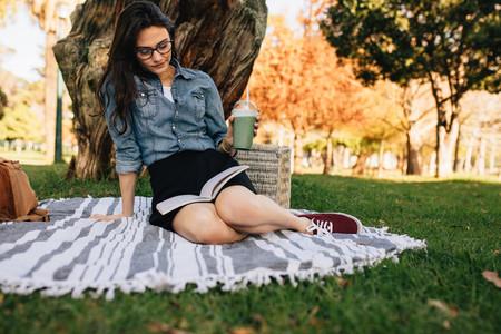 Woman enjoying book at the park