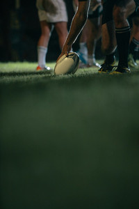 Rugby player touching down the ball