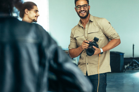 Photographer smiling during a photo shoot