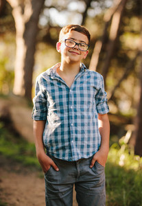 Smiling boy standing in a park