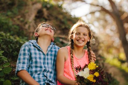 Happy kids in love sitting in a park