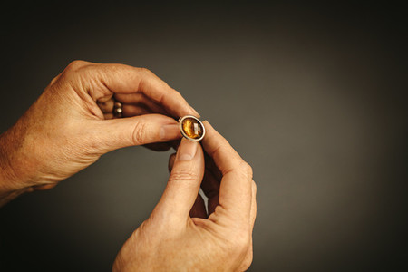 Jeweler inspecting a gemstone ring