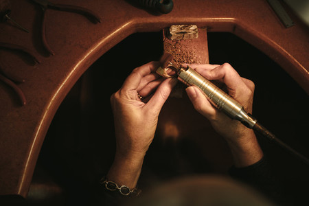 Jeweler hands polishing a ring