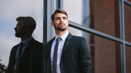 Businessman standing outside and looking away