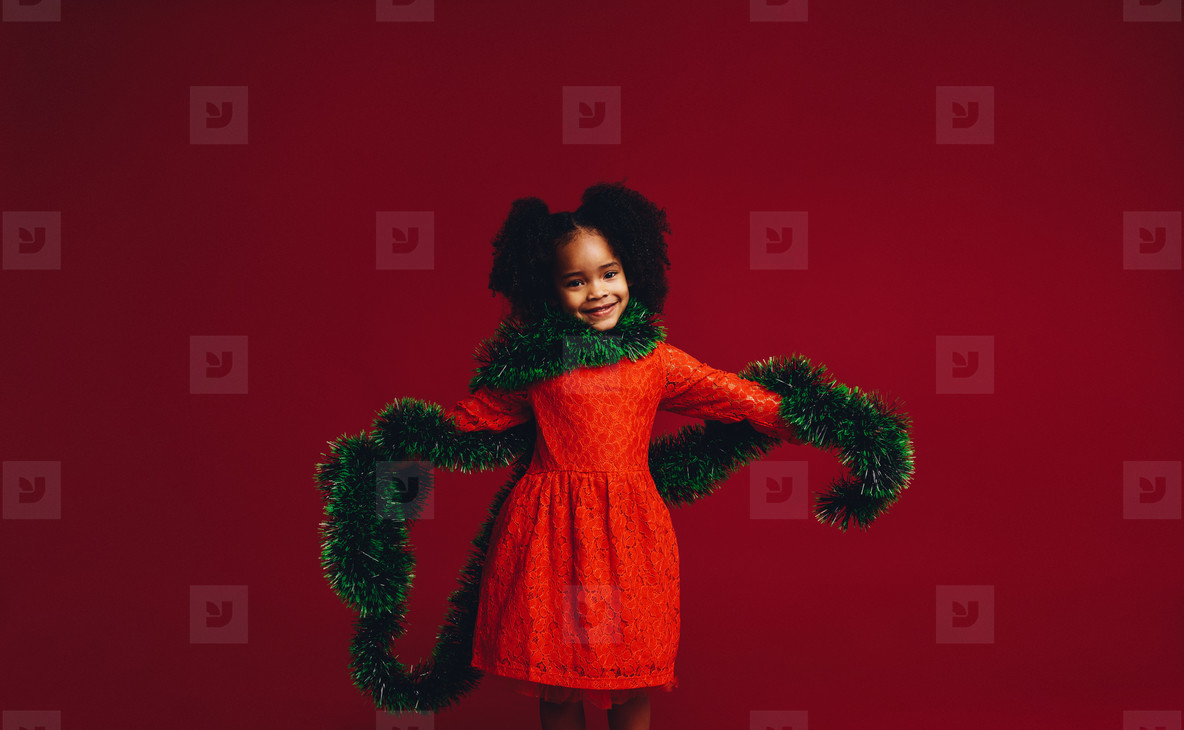 Kid playing with a decorative ribbon