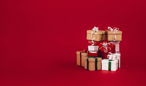 Gift boxes piled up on a red background