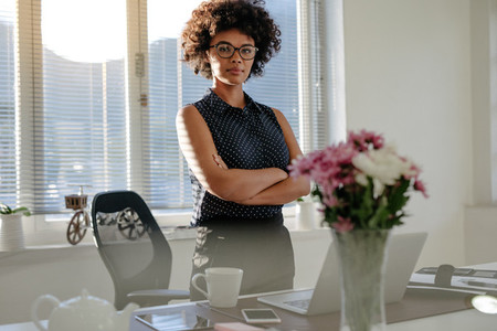 African businesswoman standing at her desk