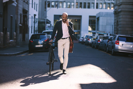 Young businessman going to work with his bicycle