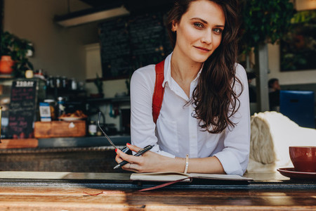 Beautiful woman sitting at coffee shop