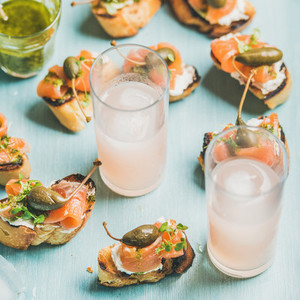 Crostini with smoked salmon and pink grapefruit cocktails  square crop