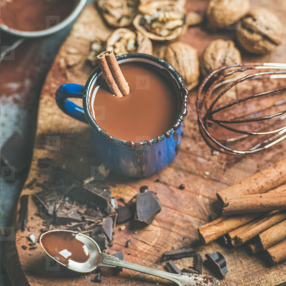 Making rich hot chocolate with cinnamon and walnuts  square crop