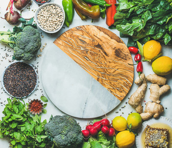 Clean eating healthy cooking ingredients with round board in center