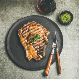 Grilled hot rib eye beef steak with red wine square crop