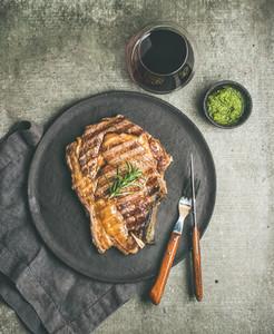 Flat lay of Grilled rib eye beef steak on bone copy space
