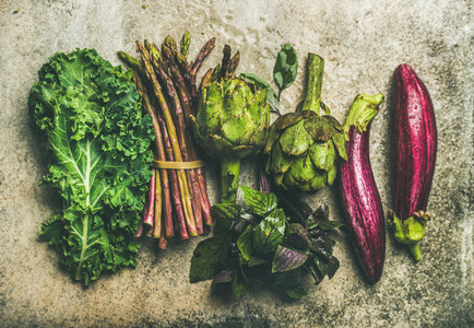 Flat lay of fresh green and purple vegetables  top view