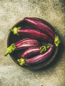 Flat lay of fresh raw Fall harvest purple eggplants or aubergines